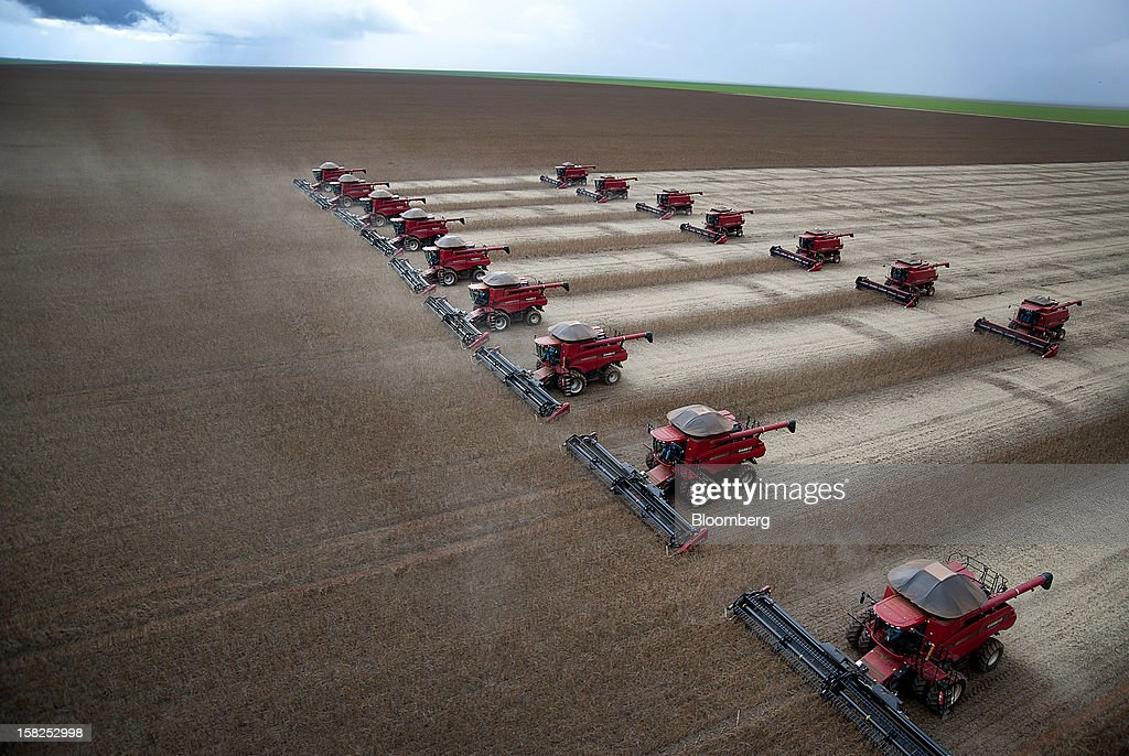 'BEST PHOTOS OF 2012' (): Combines harvest soybeans at the Morro Azul farm near Tangara da Serra, Brazil, on Tuesday, March 27, 2012. Soybean prices in Chicago may rise to $14.50 a bushel as drought hampers crops in South America, boosting the outlook for U.S. exports, said William Tierney, the chief economist at AgResource Co. in Chicago. Photographer: Paulo Fridman/Bloomberg via Getty Images