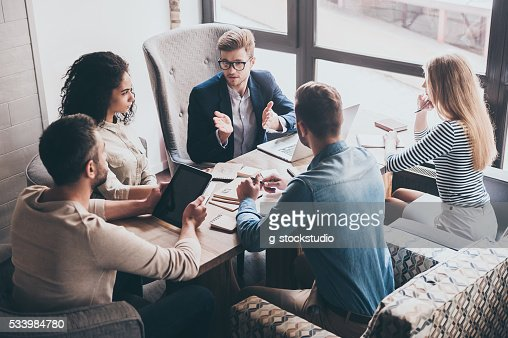 Combining their expertise. : Stock Photo