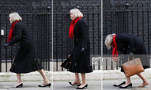 A combo of pictures shows British Home Secretary Theresa May stopping as the heal of her shoe gets stuck in a gap in the pavement as she arrives at...
