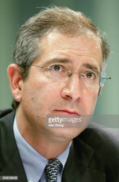 Comcast Corporation President and CEO Brian Roberts listens to questions as he testifies during a hearing reviewing telecommunications policy before...