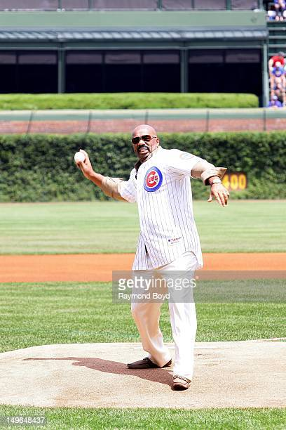 Comedian actor and author Steve Harvey throws out the ceremonial first pitch before the Chicago Cubs/St Louis Cardinals baseball game in Chicago...