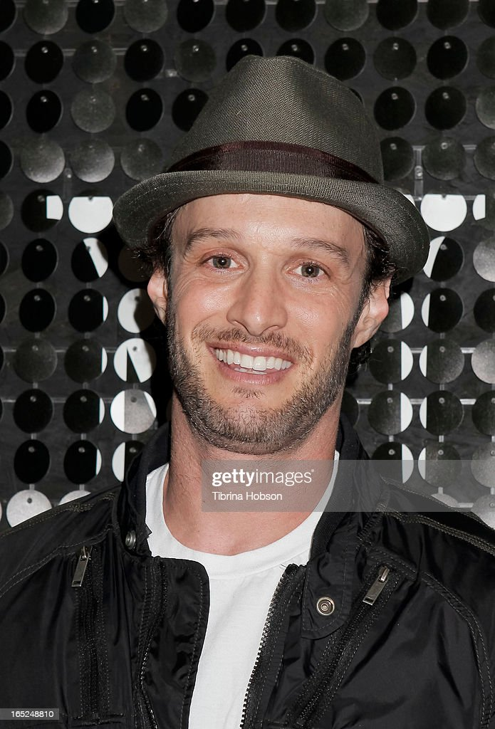 Comedian, actor and writer Josh Wolf signs copies of his book 'It Takes Balls' at Skin Body Lounge on April 1, 2013 in Studio City, California.