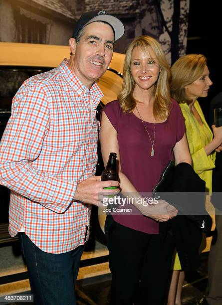 Comedian Adam Carolla and actress Lisa Kudrow attend the Worlds Greatest Sports Coupe exhibit opening celebration with Jaguar at the Petersen...