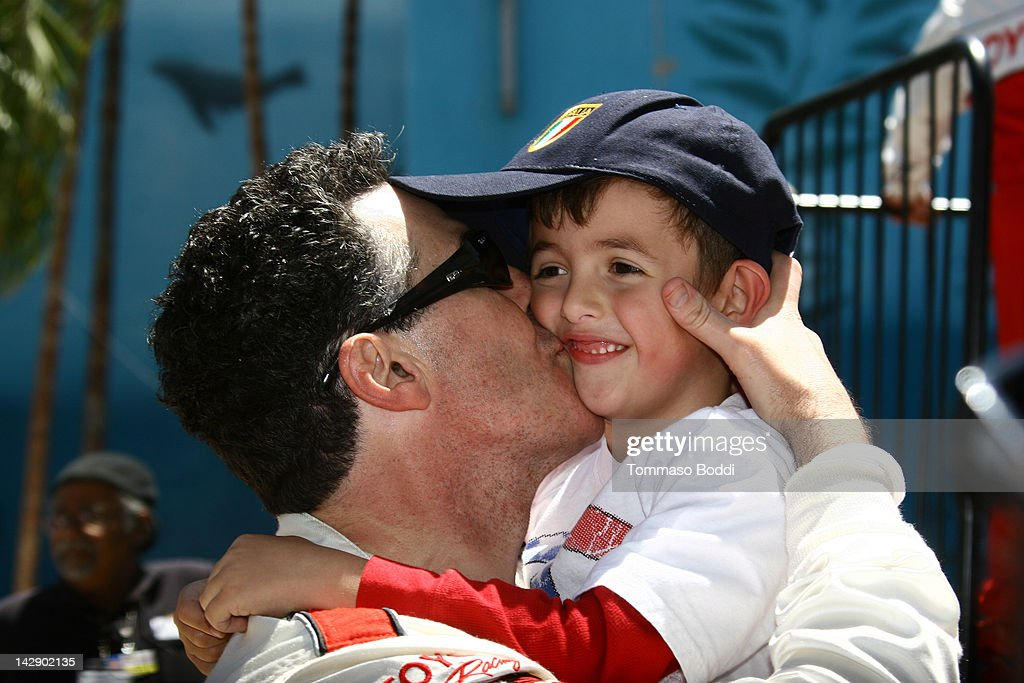 Comedian <a gi-track='captionPersonalityLinkClicked' href=/galleries/search?phrase=Adam+Carolla&family=editorial&specificpeople=226591 ng-click='$event.stopPropagation()'>Adam Carolla</a> (L) celebrates with his son after winning the 36th Annual 2012 Toyota Pro/Celebrity Race on April 14, 2012 in Long Beach, California.