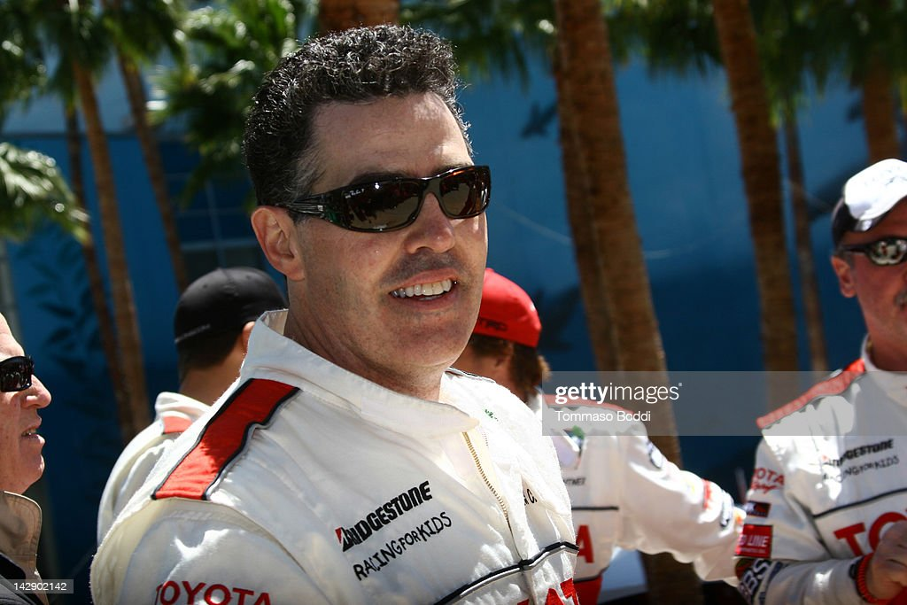 Comedian <a gi-track='captionPersonalityLinkClicked' href=/galleries/search?phrase=Adam+Carolla&family=editorial&specificpeople=226591 ng-click='$event.stopPropagation()'>Adam Carolla</a> poses after winning the 36th Annual 2012 Toyota Pro/Celebrity Race on April 14, 2012 in Long Beach, California.