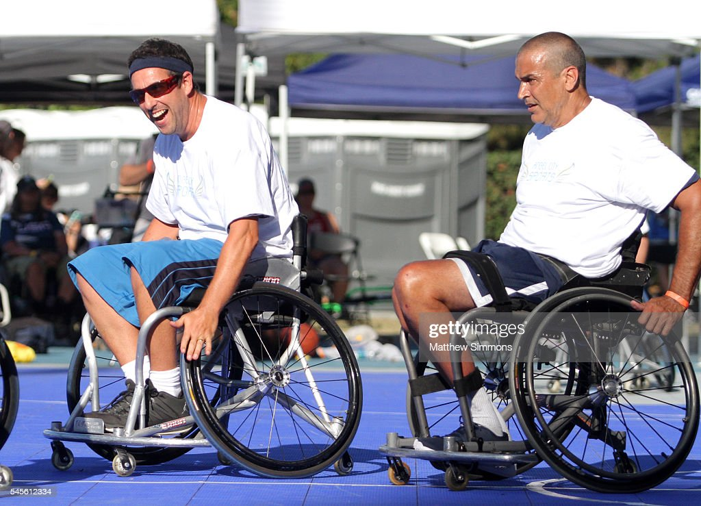 Comedian Adam Sandler and Trooper Johnson play in a celebrity wheelchair basketball game during the 2nd Annual Angel City Games at UCLA's Drake...