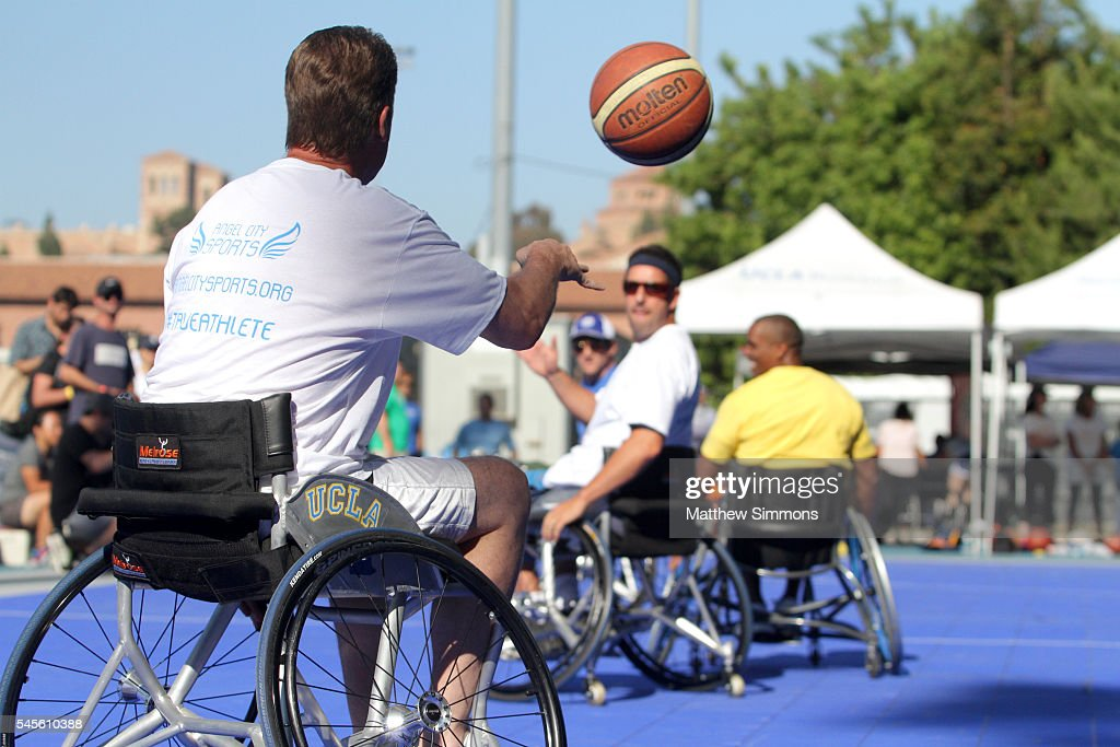 Comedian Adam Sandler plays in a celebrity wheelchair basketball game during the 2nd Annual Angel City Games at UCLA's Drake Stadium on July 8 2016...