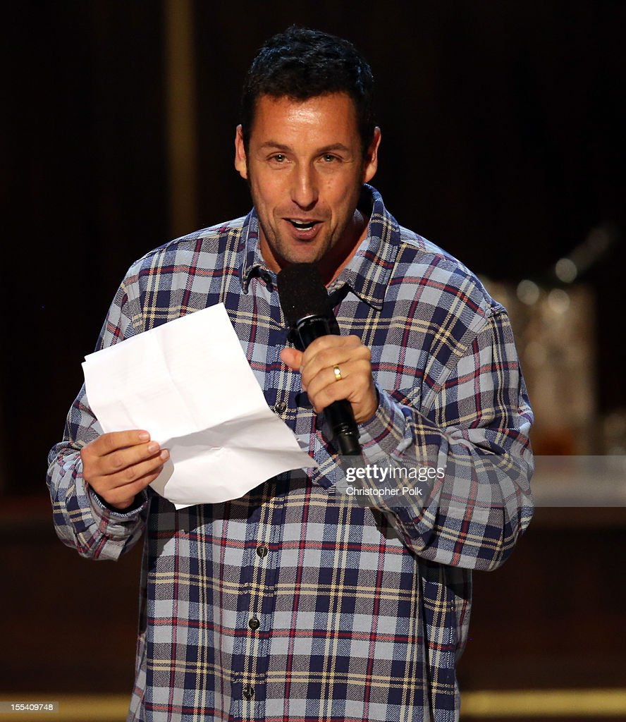 Comedian <a gi-track='captionPersonalityLinkClicked' href=/galleries/search?phrase=Adam+Sandler&family=editorial&specificpeople=202205 ng-click='$event.stopPropagation()'>Adam Sandler</a> speaks onstage at Spike TV's 'Eddie Murphy: One Night Only' at the Saban Theatre on November 3, 2012 in Beverly Hills, California.