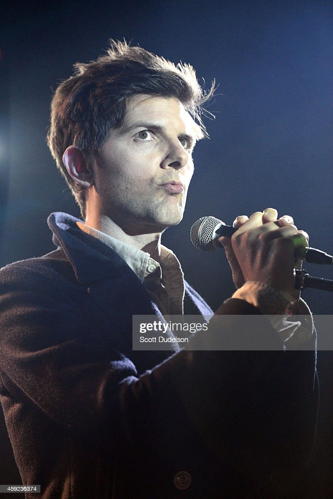Comedian Adam Scott performs on stage at the Fun Lovers Unite! A Benefit for Moms Demand Action at the Echoplex on November 18, 2014 in Los Angeles, California.