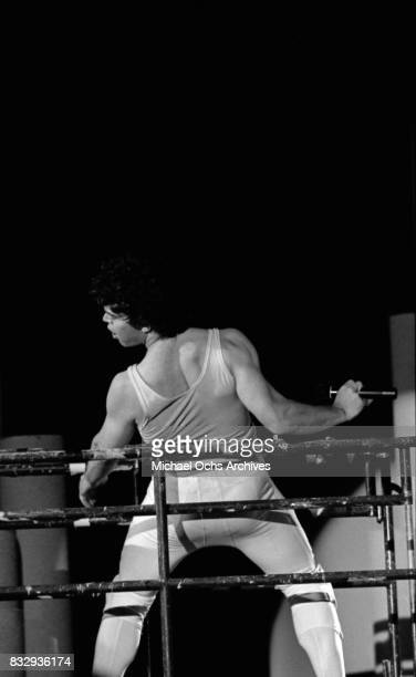 Comedian Al Franken performs onstage dressed as Mick Jagger at a performance with Tom Davis of the comedy group 'Franken and Davis' at Stockton State...