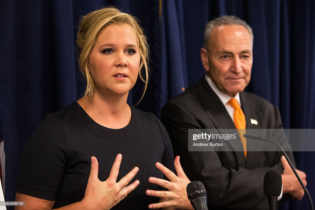 Comedian <a gi-track='captionPersonalityLinkClicked' href=/galleries/search?phrase=Amy+Schumer&family=editorial&specificpeople=4680682 ng-click='$event.stopPropagation()'>Amy Schumer</a> (L) and U.S. Senator Chuck Schumer (D-NY) speak at a press conference calling for tighter gun laws in an effort to stop mass shootings and gun violence on August 3, 2015 in New York City. A gunman killed two women last month in Louisiana during a showing of Schumer's movie 'Trainwreck.'