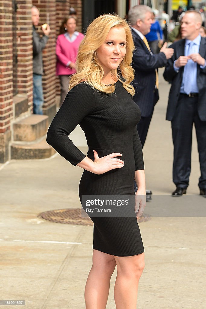 Comedian <a gi-track='captionPersonalityLinkClicked' href=/galleries/search?phrase=Amy+Schumer&family=editorial&specificpeople=4680682 ng-click='$event.stopPropagation()'>Amy Schumer</a> enters the 'Late Show With David Letterman' taping at the Ed Sullivan Theater on April 1, 2014 in New York City.