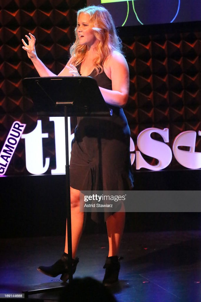 Comedian <a gi-track='captionPersonalityLinkClicked' href=/galleries/search?phrase=Amy+Schumer&family=editorial&specificpeople=4680682 ng-click='$event.stopPropagation()'>Amy Schumer</a> performs at Glamour's presentation of 'These Girls' at Joe's Pub on May 20, 2013 in New York City.