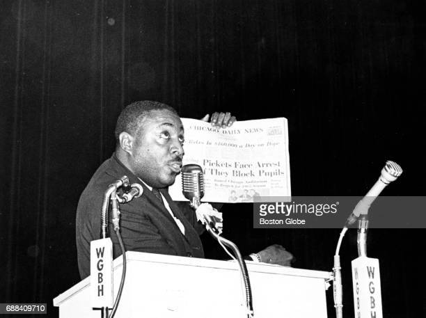 Comedian and activist Dick Gregory holds up a newspaper at a rally in preparation for a Boston Freedom StayOut boycott at the Donnelly Memorial...