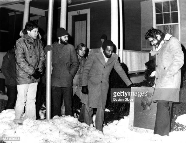 Comedian and activist Dick Gregory second from right and Washington author Mark Lane far right lead an overnight vigil at the birthplace of John F...