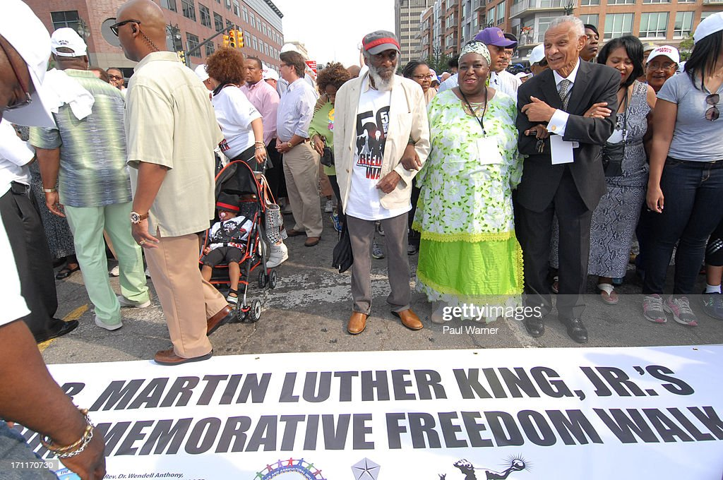 Comedian and activist Dick Gregory walks in the 50th Anniversary Freedom March on June 22, 2013 in Detroit, Michigan.