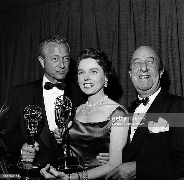 Comedian and actor Ed Wynn poses with actor Robert Young and actress Jane Wyatt after they won Emmy Awards during the 10th Primetime Emmy Awards in...