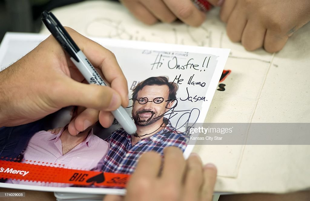 Comedian and Kansas City-born actor Jason Sudeikis autographs a photo of himself during a visit to patients at Children's Mercy Hospital on Friday, July 19, 2013, with fellow comedian actors Paul Rudd and Rob Riggle prior to this weekend's 4th Annual Big Slick Celebrity Poker Tournament and Party to benefit the Cancer Center at Children's Mercy Hospital and Clinics.