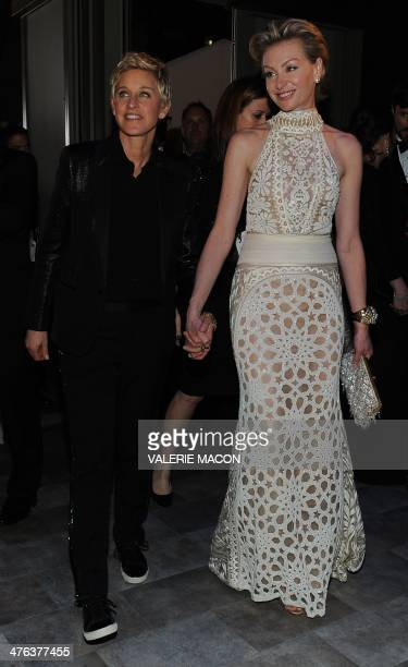 Comedian and Oscars host Ellen DeGeneres arrives with Portia de Rossi at the Governor's Ball following the 86th Academy Awards on March 2nd 2014 in...