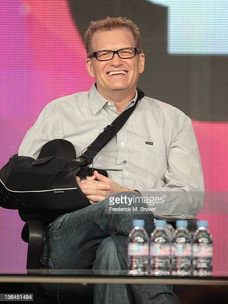 Comedian and TV Host Drew Carey speaks onstage during the American Masters 'Johnny Carson King of Late Night' panel during the PBS portion of the...