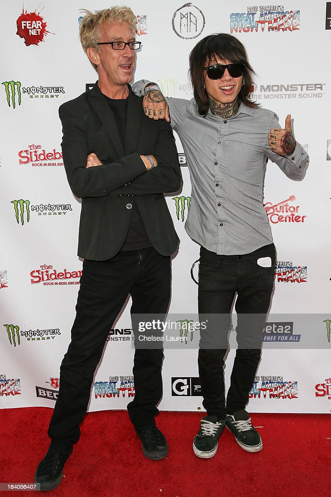 Comedian Andy Dick (L) and musician Joey Alva attend Rob Zombie's Great American Nightmare VIP opening night party at Pomona FEARplex on October 10, 2013 in Pomona, California.