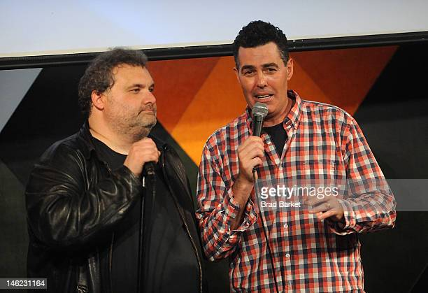 Comedian Artie Lange and Adam Carolla perform on stage at Adam Carolla's 'Not Taco Bell Material' Webinar at Caroline's On Broadway on June 12 2012...