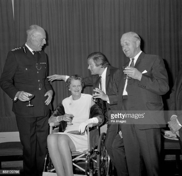 Comedian Benny Hill entertains Sir John Waldron Metropolitan Police Commissioner and his wife Lady Waldron and Detective Chief Superintendent R C...