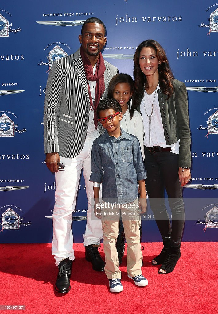 Comedian <a gi-track='captionPersonalityLinkClicked' href=/galleries/search?phrase=Bill+Bellamy&family=editorial&specificpeople=241222 ng-click='$event.stopPropagation()'>Bill Bellamy</a> (L) and his family attend John Varvatos 10th Annual Stuart House Benefit Presented by Chrysler, at John Varvatos Los Angeles on March 10, 2013 in Los Angeles, California.