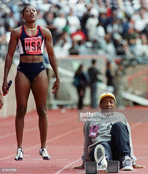 US comedian Bill Cosby backs up the starting blocks for Inger Miller of the US prior to the start of the Women's 4X100 Relay at the Penn Relays 29...