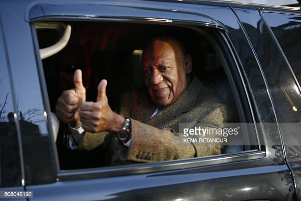 US comedian Bill Cosby gives a thumbs up as he leaves the Montgomery County courthouse in Norristown Pennsylvania on February 2 2016 Cosby was in the...