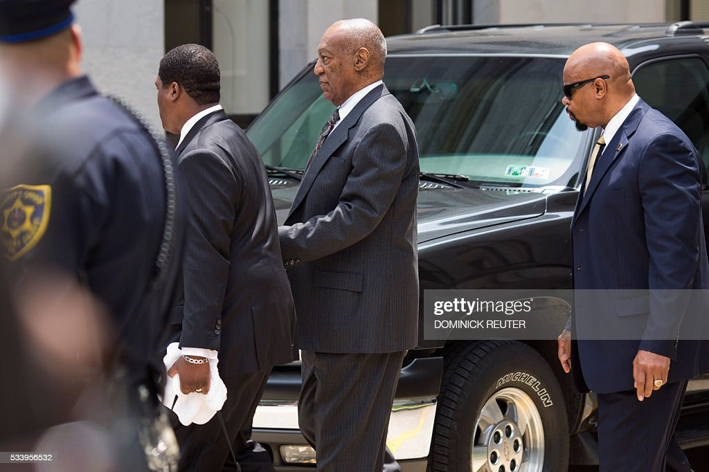 Comedian Bill Cosby leaves the Montgomery County Courthouse after being ordered to stand trail for assault charges, May 24, 2016,in Norristown, Pennsylvania. Disgraced television legend Bill Cosby will face trial over accusations that he sexually assaulted a woman after plying her with drugs at his Philadelphia home 12 years ago, a judge ruled Tuesday.The 78-year-old pioneering black comedian looked subdued and kept his glance averted from onlookers as he left a county court house in Pennsylvania, dressed in a grey suit and floral tie, leaning on a member of his entourage. REUTER
