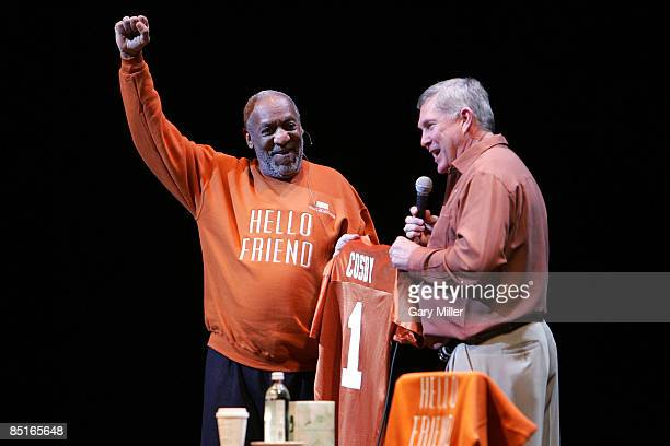 Comedian Bill Cosby receives a UT Longhorns jersey from football coach Mack Brown at the start of his performance at the Bass Concert Hall on...