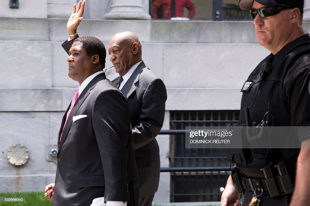Comedian Bill Cosby waves as he leaves the Montgomery County Courthouse after being ordered to stand trail for assault charges, May 24, 2016, in Norristown, Pennsylvania. Disgraced television legend Bill Cosby will face trial over accusations that he sexually assaulted a woman after plying her with drugs at his Philadelphia home 12 years ago, a judge ruled Tuesday.The 78-year-old pioneering black comedian looked subdued and kept his glance averted from onlookers as he left a county court house in Pennsylvania, dressed in a grey suit and floral tie, leaning on a member of his entourage. REUTER