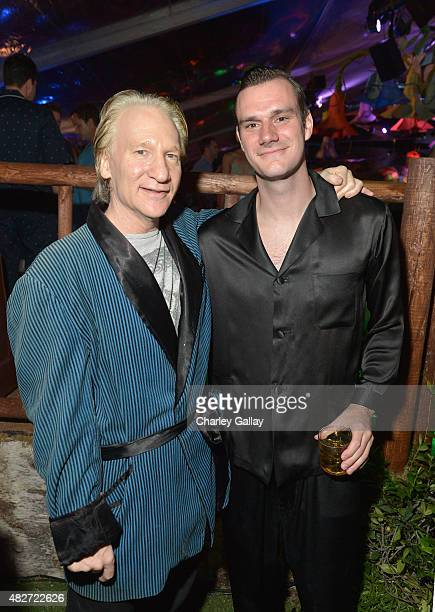 Comedian Bill Maher and Cooper Hefner attend the annual Midsummer Night's Dream Party at the Playboy Mansion hosted by Hugh Hefner on August 1 2015...