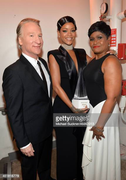Comedian Bill Maher singer Rihanna and Monica Braithwaite attend the 2013 American Music Awards at Nokia Theatre LA Live on November 24 2013 in Los...