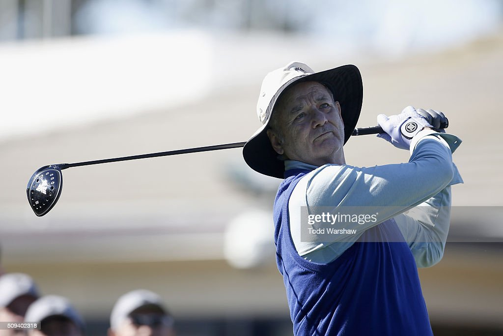 Comedian Bill Murray tees off on the 1st hole during the 3M Celebrity Challenge prior to the ATT Pebble Beach National ProAm at Pebble Beach Golf...