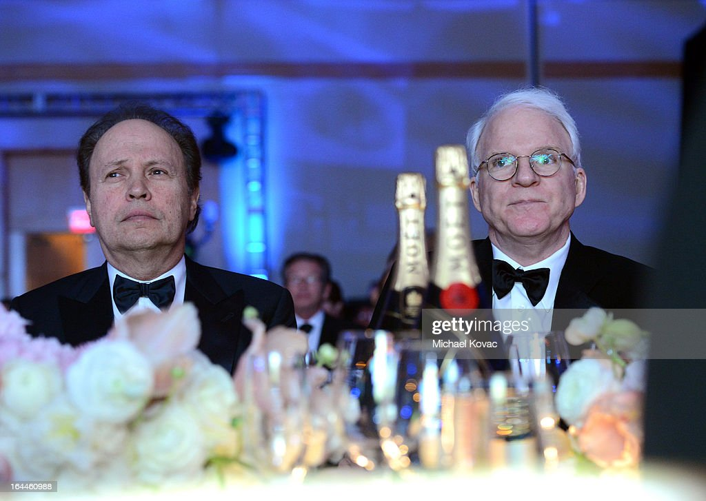 Comedian Billy Crystal and Steve Martin with Moet & Chandon at Celebrity Fight Night XIX at JW Marriott Desert Ridge Resort & Spa on March 23, 2013 in Phoenix, Arizona.