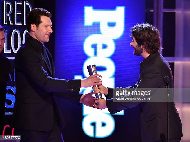Comedian Billy Eichner accepts Breakout Star of the Year from singer Josh Groban onstage during the PEOPLE Magazine Awards at The Beverly Hilton...