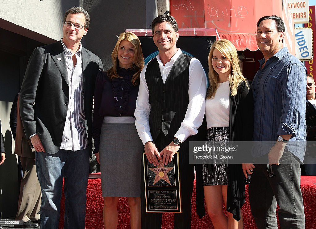 Comedian <a gi-track='captionPersonalityLinkClicked' href=/galleries/search?phrase=Bob+Saget&family=editorial&specificpeople=209388 ng-click='$event.stopPropagation()'>Bob Saget</a>, producer Lori Laughlin, actor <a gi-track='captionPersonalityLinkClicked' href=/galleries/search?phrase=John+Stamos&family=editorial&specificpeople=206285 ng-click='$event.stopPropagation()'>John Stamos</a>, actress Candice Bure and Jeff Franklin pose during induction ceremony on the Hollywood Walk of Fame on November 16, 2009 in Hollywood, California.