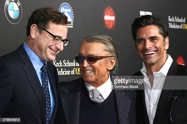 Comedian Bob Saget producer Robert Evans and actor John Stamos attend the 2nd annual Rebel With a Cause Gala held at the Paramount Studios on March...