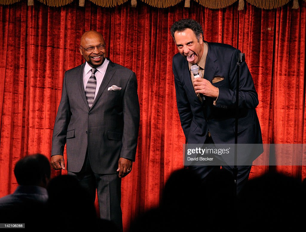 Comedian Brad Garrett jokes with Tony Camacho at the grand opening of Brad Garrett's Comedy Club at the MGM Grand Hotel/Casino on March 29 2012 in...