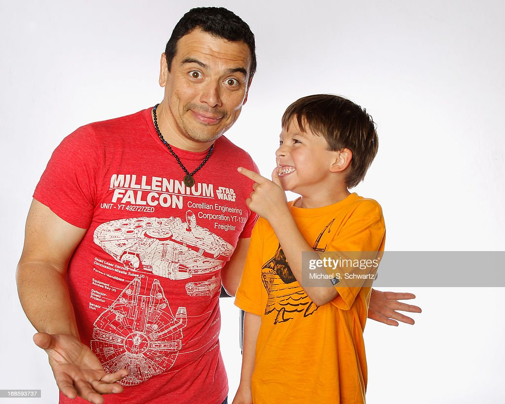 Comedian <a gi-track='captionPersonalityLinkClicked' href=/galleries/search?phrase=Carlos+Mencia&family=editorial&specificpeople=539025 ng-click='$event.stopPropagation()'>Carlos Mencia</a> (L) and Lucas Mencia pose during their attendance at The Ice House Comedy Club on May 11, 2013 in Pasadena, California.