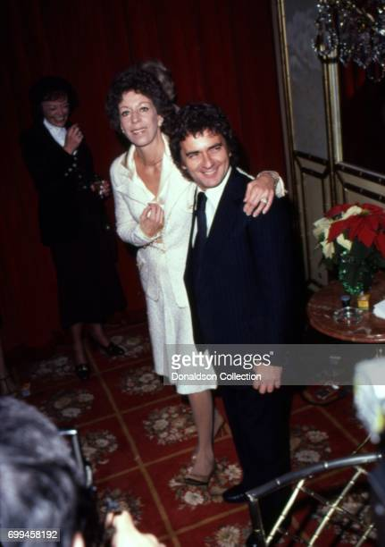 Comedian Carol Burnett poses with Dudley Moore as she receives the award for 'presenting the best Hollywood image to the world' from the Hollywood...