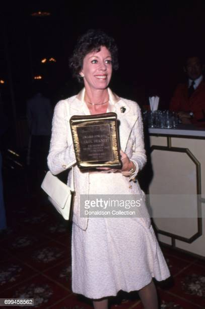 Comedian Carol Burnett receives the award for 'presenting the best Hollywood image to the world' from the Hollywood Women's Press Club in September...