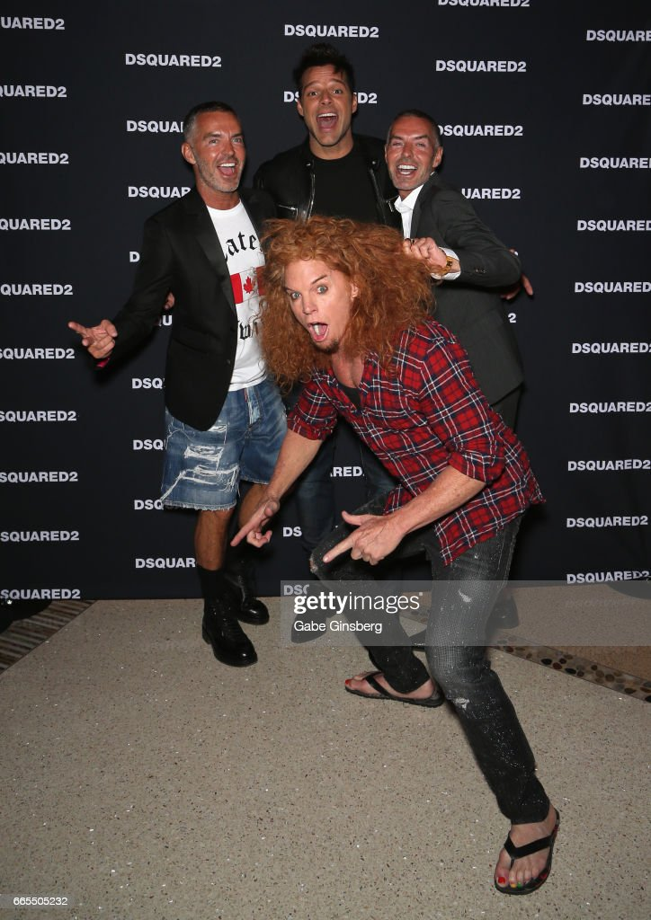 Comedian Carrot Top (front) photobombs (L-R) fashion designer Dan Caten, recording artist Ricky Martin and fashion designer Dean Caten as they attend the grand opening party for Dsquared2 at The Shops at Crystals on April 6, 2017 in Las Vegas, Nevada.