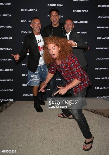 Comedian Carrot Top photobombs fashion designer Dan Caten recording artist Ricky Martin and fashion designer Dean Caten as they attend the grand...