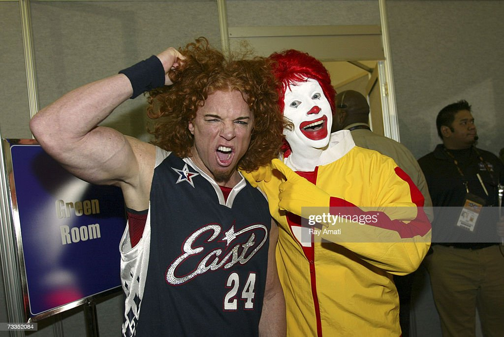 Comedian Carrot Top poses with Ronald McDonald at the McDonald's NBA AllStar Celebrity Game Presented by 2K Sports at NBA Jam Session Center Court in...