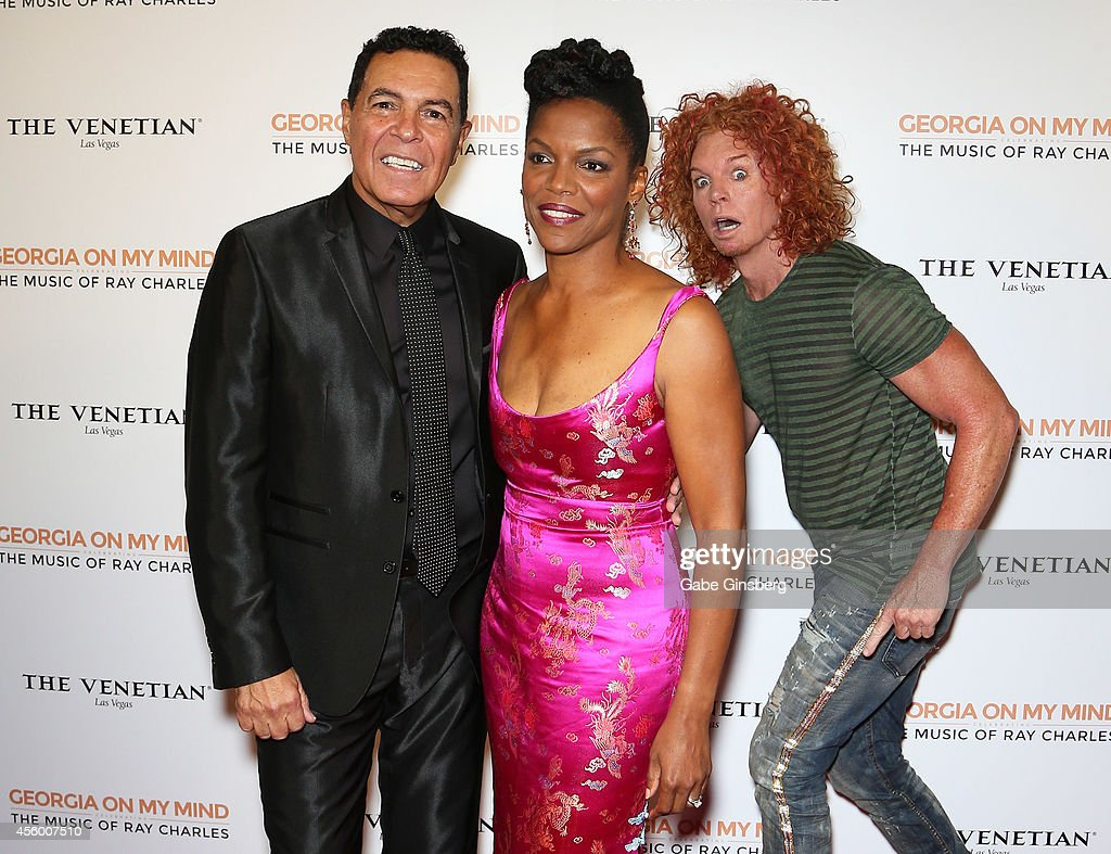 Comedian Carrot Top walks behind singers Clint Holmes and Nnenna Freelon as they arrives at 'Georgia On My Mind Celebrating The Music Of Ray Charles'...