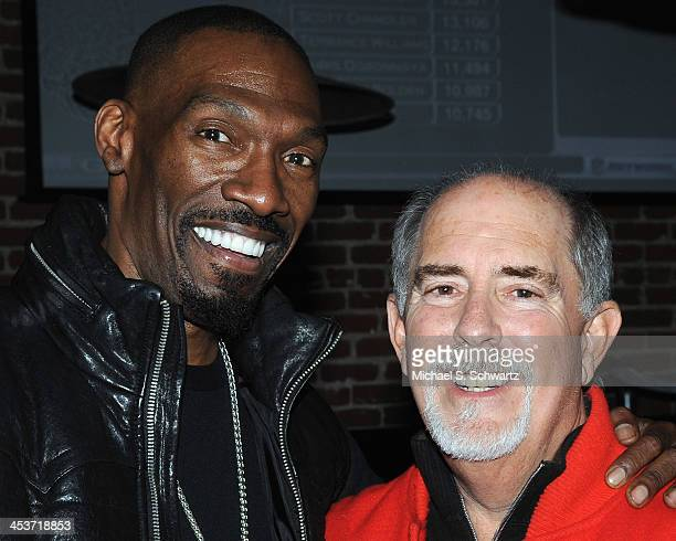 Comedian Charlie Murphy and Ice House owner Bob Fisher pose during their attendance at The Ice House Comedy Club on December 4 2013 in Pasadena...