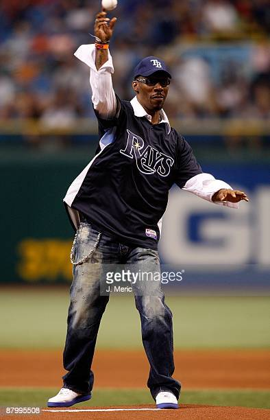 Comedian Charlie Murphy throws out the first pitch just before the start of the game between the Tampa Bay Rays and the Cleveland Indians at...